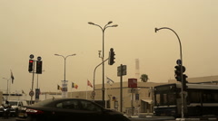 Sand storm, heavy air pollution at Tel-Aviv intersection, Israel Stock Footage