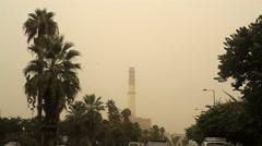Cars drive in severe sand storm, Tel-Aviv, Israel Stock Footage