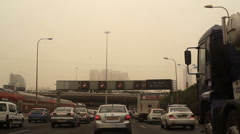 Traffic on Ayalon highway in Tel-Aviv during severe sand storm, Israel Stock Footage