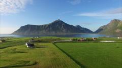 Flying over scenic village Flakstad on Lofoten Stock Footage