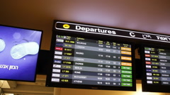 Flight departures screen at airport Stock Footage