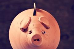 coin in a piggy bank, filtered - stock photo