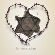 Jewish badge and text in memoriam - stock photo