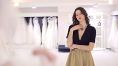 girlfriend appreciates wedding dress - stock footage