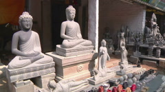 Pan zoom shot of stone statues in Mamallapuram, India Stock Footage