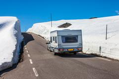 Caravan car travels on the highway. Stock Photos