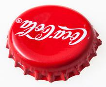 Used red bottle cap from the Coca-Cola Stock Photos