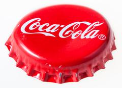 Used red crown cork cap from bottle of Coca-Cola - stock photo