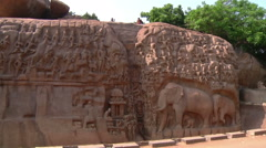 Pan WS of an ancient wall carving near a cave  in Mamallapuram, India Stock Footage