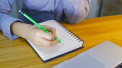 Close up the girl drawing the sketch of the person by pencil. Stock Footage