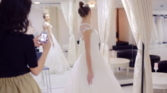 Wedding Dress Fitting in Bridal store Stock Footage