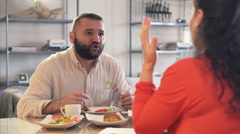 Young couple fighting, arguing during breakfast at home Stock Footage