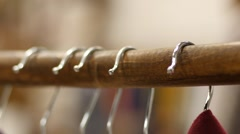 Hanger hooks in a clothing store - shopping a new clothes Stock Footage