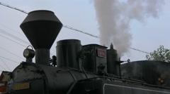 Close view Mocanita's locomotive steaming Stock Footage