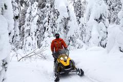 Athlete on a snowmobile - stock photo