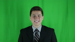 Young businessman is happy and pumps fists in front of a greenscreen - stock footage