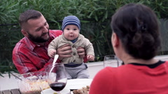 Stock Video Footage of Happy family talking during dinner on terrace