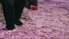 People's feet are on the snow in the colors of illumination Stock Footage