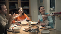 Young group of friends talking eating dinner at home Stock Footage