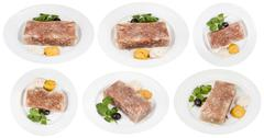 Set of white plates with beef aspic isolated Stock Photos