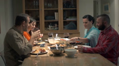 Young group of friends talking and eating dinner at home Stock Footage