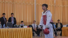 Male taekwondo player gets instructions from coach,Ubon Ratchathani,Thailand Stock Footage