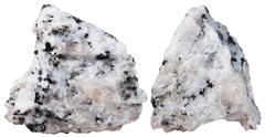Two pieces of Diorite mineral stone isolated Stock Photos