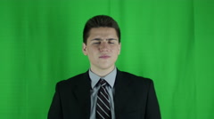 Young businessman is annoyed in front of greenscreen - stock footage