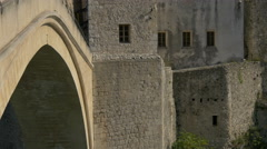 View of Stari Most and the southwestern tower in Mostar, Bosnia-Herzegovina Stock Footage