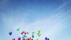 Lots of balloons floating up into the sky UHD 4K proresHQ Stock Footage