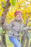Girl at the autumn tree Stock Photos
