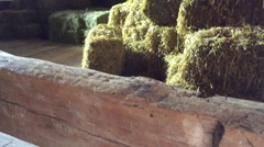 Old West Establishing Shot Winter Time - Hay Bales in old barn Stock Footage