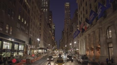 Car traffic driving through new york city midtown at night Stock Footage