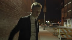 excited young businessman dancing in the city street at night. shot on red epic - stock footage