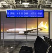 Cancelled flight at airport Stock Photos