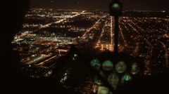 Helicopter shot of airplanes arriving at international airport terminal at night Stock Footage