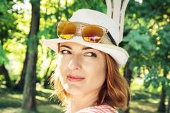 Portrait of young positive caucasian woman in outdoors - stock photo