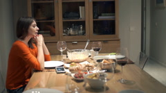Impatient woman waiting for her boyfriend with dinner at home - stock footage