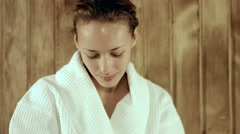 Relaxing woman stroking her skin in the sauna Stock Footage