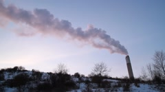 Smoke from chimney stack against winter sky Stock Footage