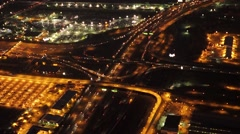 Aerial view of illuminated highway traffic road at night. cars driving freeway - stock footage