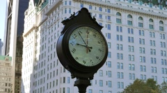 time lapse of people walking through the city. watch clock background - stock footage