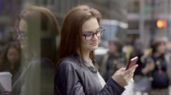 Young women using smart phone tablet computer outdoors. shot on red epic - stock footage