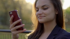 lifestyle portrait of beautiful women browsing the web on smart phone tablet - stock footage