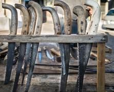 Old hacksaws handmade using the worn blades of scythes. Stock Photos