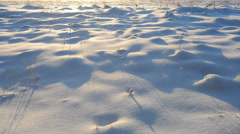 Man walking on snow and leaving tracks Stock Footage