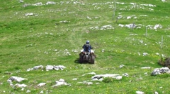 Man driving a quad drive bike (ATV) - stock footage