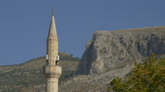 Beautiful view of the mosque's tower and mountains in Mostar, Bosnia-Herzegovina - stock footage