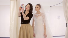 Bride and her friend take selfie Stock Footage