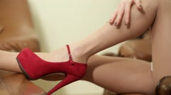 Girl in red shoes sexy stroking her legs Stock Footage
